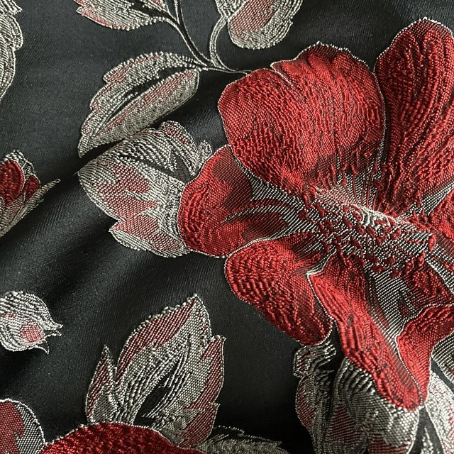 3D flowers jacquard in red on gray background