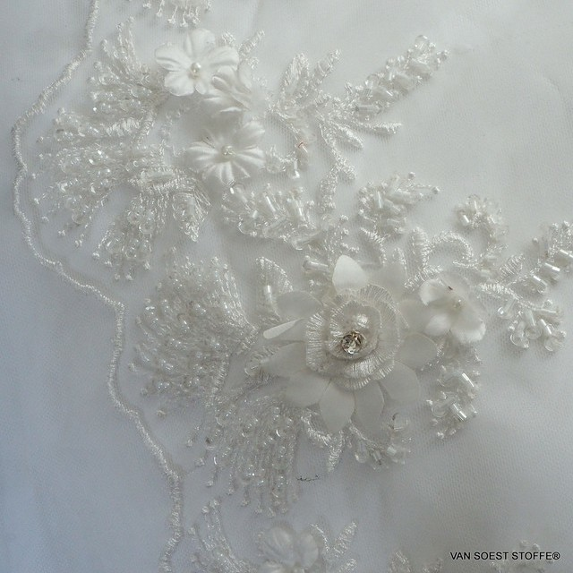 3D-lace with stabs-pearls and mini sequins tone in tone in white