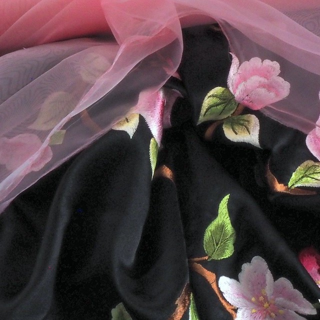 Allover roses tendril embroidery on black satin fabric