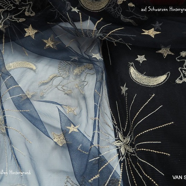 Embroidered gold / silver stars + figures on navy tulle