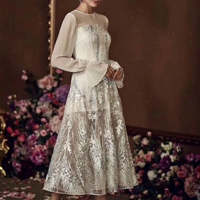 Couture guipure borders lace on skin-colored tulle | View: Couture guipure borders lace on skin-colored tulle