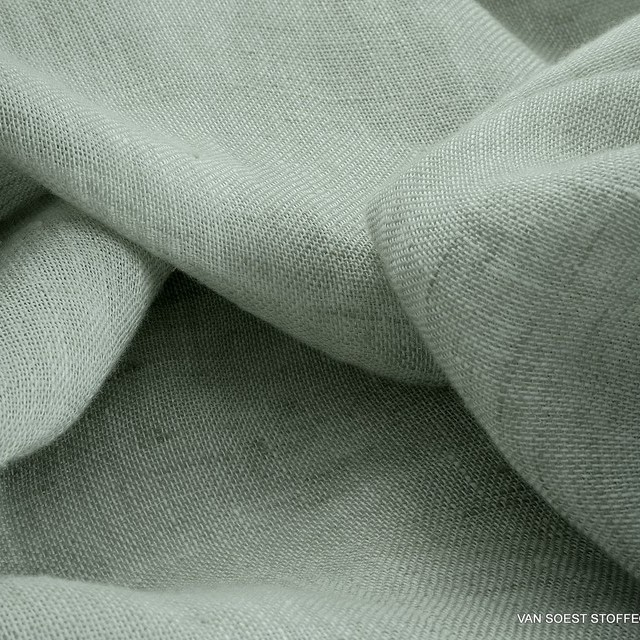 Exclusive linen fabric in delicate pastel lime green