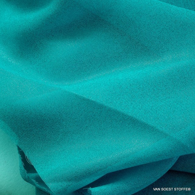 Glitter chiffon in light turquoise