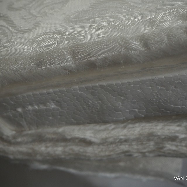High quality jacquard lining fabric in panna.