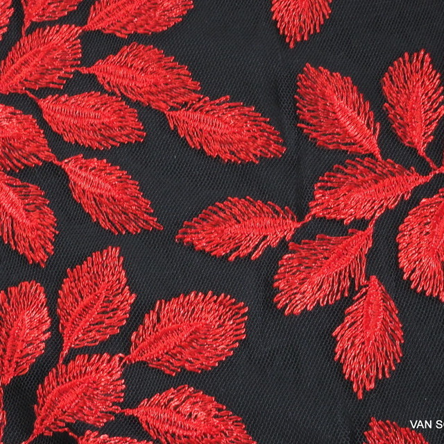 Red leaves on soft black soft tulle