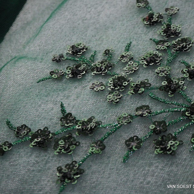 Fir green branches of mini sequins on green colored tulle. | View: Fir green branches of mini sequins on green colored tulle.