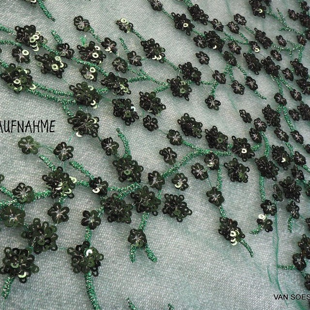 Fir green branches of mini sequins on green colored tulle.