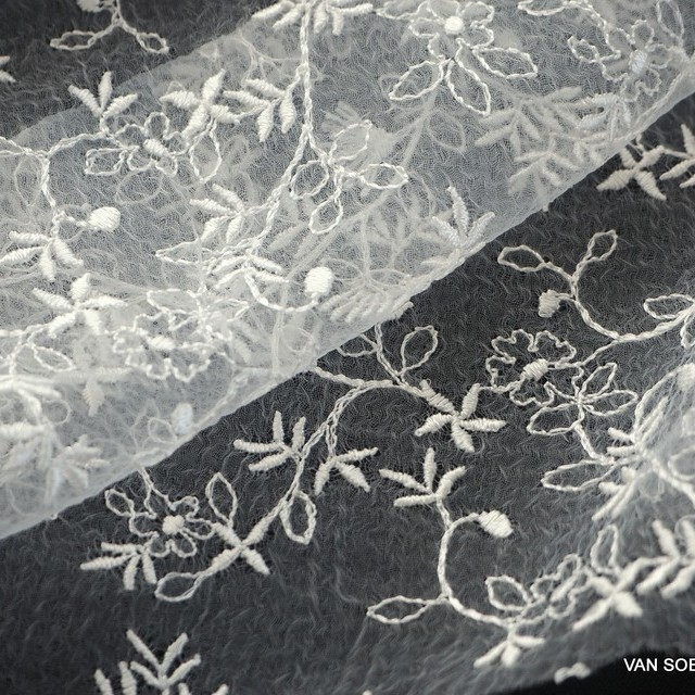 Allover flower lace on ivory organza. | View: Allover flower lace on ivory organza.