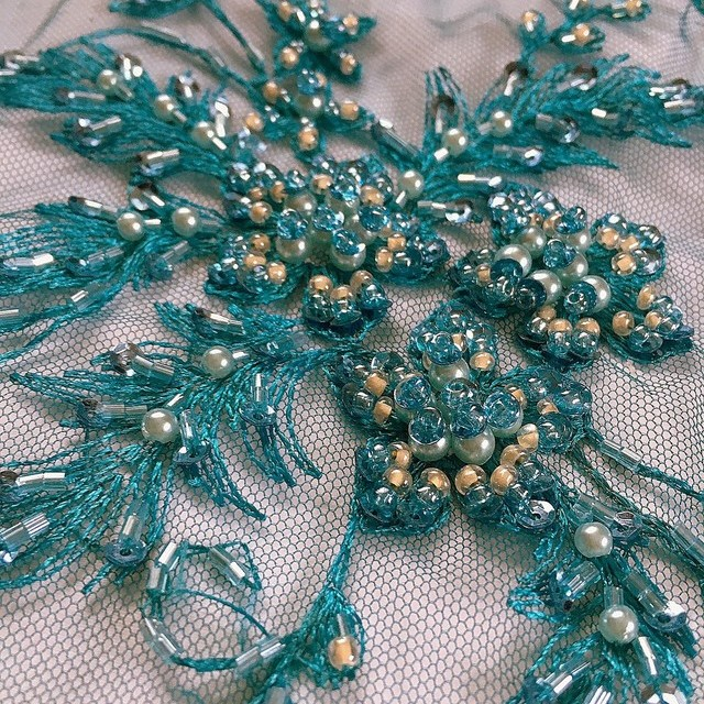 Turquoise high-quality & extraordinary lace with pearls, sequins & sticks on tulle