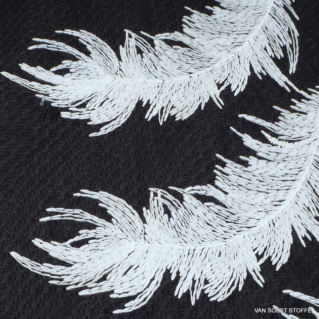 White feathers on black fantasy tulle