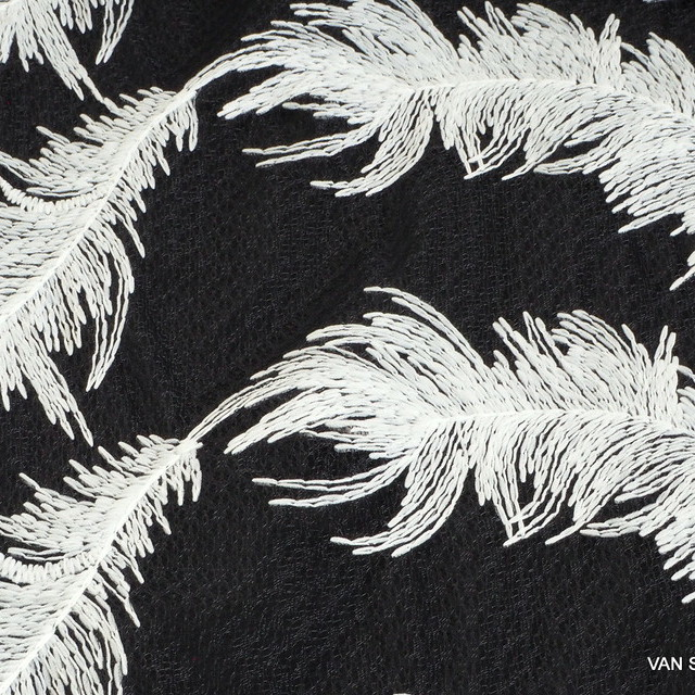 White feathers on black fantasy tulle | View: White feathers on black fantasy tulle